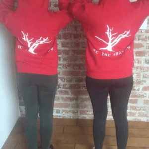 employees showing off red branch hoodies