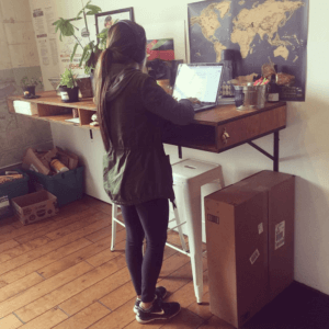 standing and working on computer