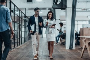 employer waling through the office doing onboarding