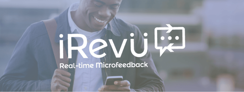 smiling man on phone using microfeedback application with blue overlay