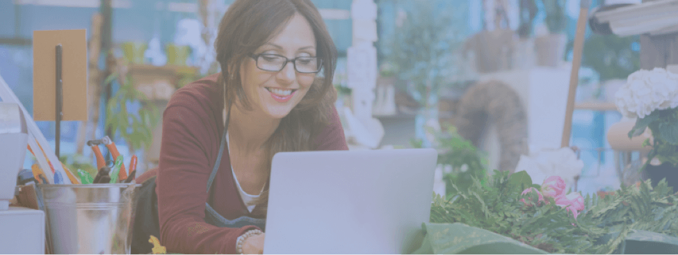 employee receiving feedback from online hrtech tool with irevu blue overlay
