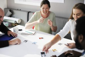 employees playing a game at a table