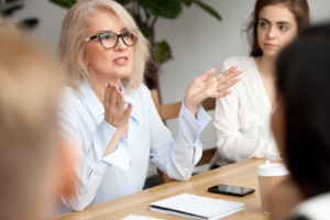 leader training employees at conference table