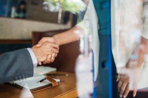 hand shake professional woman desk