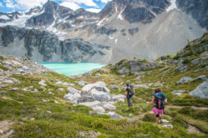 mountain landscape lake hiker leader
