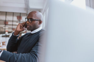 man on cell phone in office