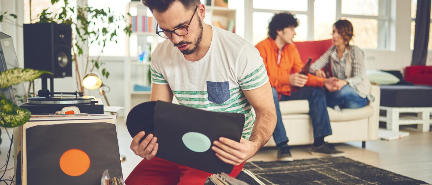 Man holding vinyl record