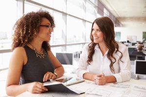 Management discussing leadership development
