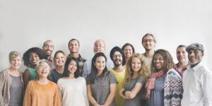 A unique, diverse team posing for a group picure