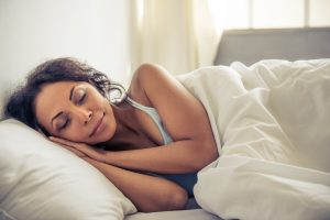 Woman sleeping soundly after using mindfulness performance management tech