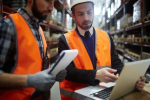 manufacturing workers using performance management tech