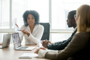 Manager using coaching strategies to help employees grow