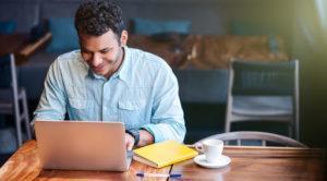 Man hiring salesperson over computer